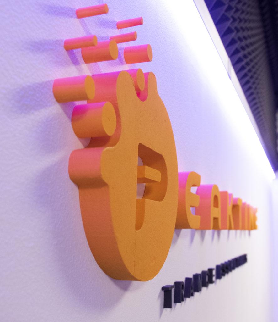 Logo Peaktime on Wall 1